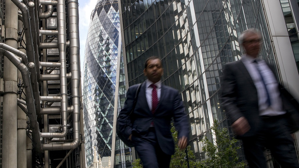 Men walk through buildings in the City of London on August 9, 2019. - Britain's economy unexpectedly shrank in the second quarter, official data showed Friday, with output faltering on Brexit turmoil. Gross domestic product dipped 0.2 percent in the April-June period after growth of 0.5 percent in the first quarter, the Office for National Statistics said in a statement. Expectations had been for zero growth. (Photo by Tolga Akmen / AFP)        (Photo credit should read TOLGA AKMEN/AFP/Getty Images)