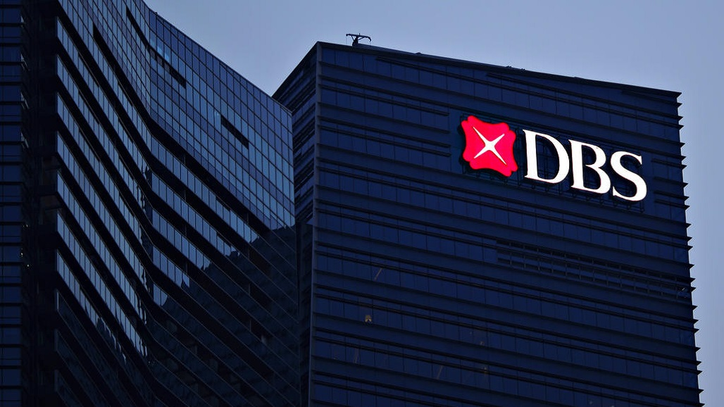 The logo and sign of DBS bank is pictured on a building that houses its headquarters at the Marina Bay Financial Centre in Singapore September 29, 2012.  REUTERS/Tim Chong (SINGAPORE - Tags: BUSINESS LOGO)